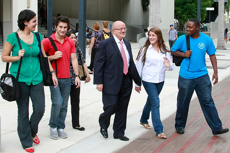 Dr. Padron walking with students