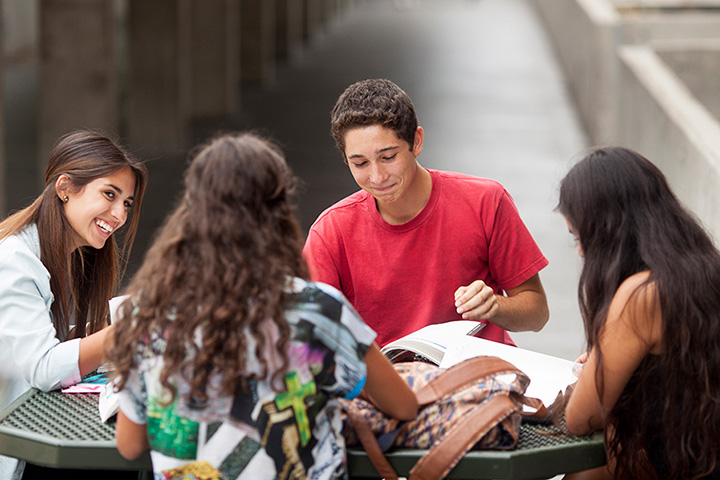 0a9cf54734e9 students studying at a table outside