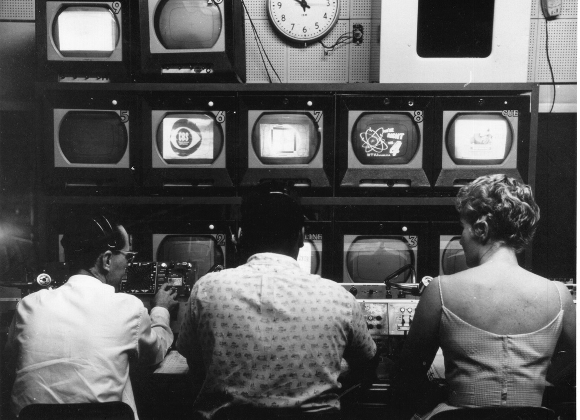 People in front of TV control console
