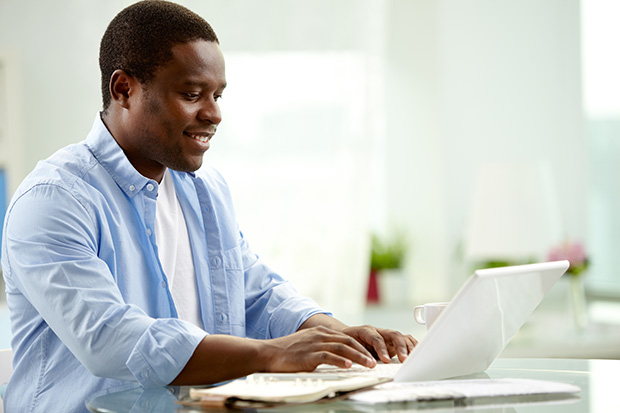 student using a laptop at home