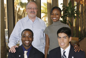 MDC President Dr. Eduardo J. Padrón, student scholarship recipients Rose-Taina Honorat, and seated from left, Gershom Jones and Christian Moreno.