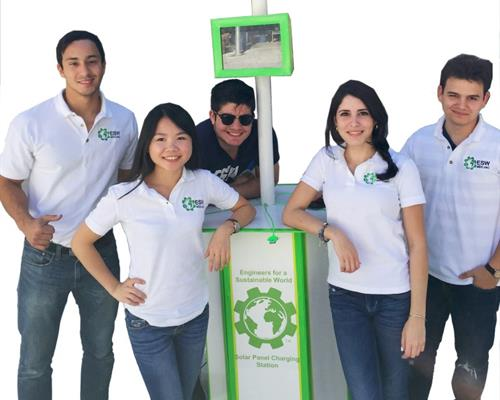 InterAmerican Campus team with mobile phone charger;