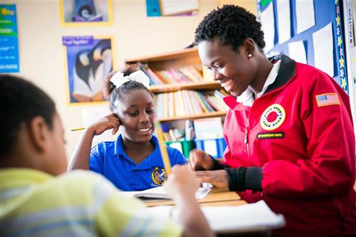 City Year volunteer with children