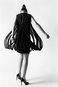 A model twirls in a uniquely tailored dress.