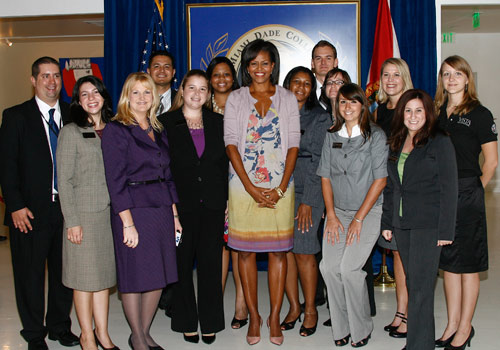 Michelle Obama surrounded by Campus Compact luncheon guests