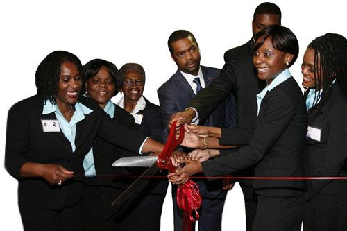 People cutting ribbon