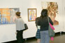 Viewers enjoy a gallery exhibition.