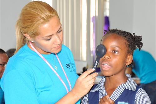Student performing eye exam