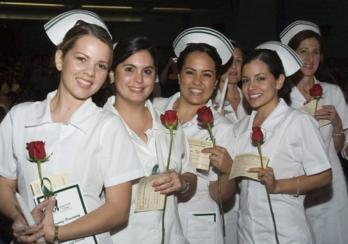 Nursing students celebrate at a lighting ceremony.