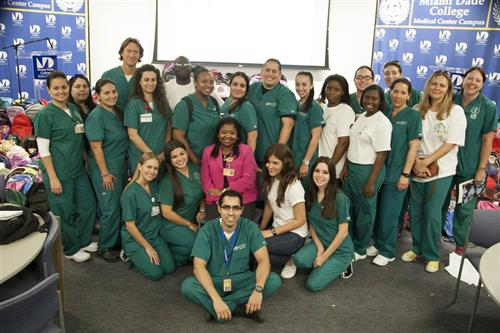 MDC Nursing Professor Dr. Marie O. Etienne and MDC students with donated backpacks