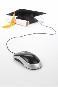 Mortarboard, diploma and computer mouse