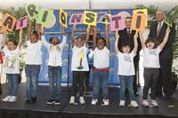 Students unveiling preschool name