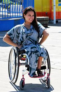 Woman in wheelchair wearing Ag Apparel design