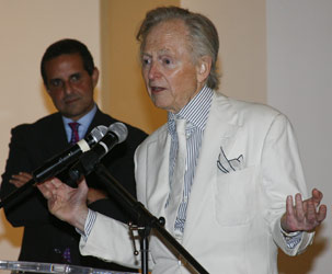 Tom Wolfe standing at podium