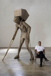 Artist Enrique Martínez Celaya with his sculpture The Tower of Snow