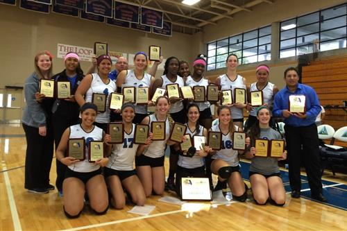 MDC's women's volleyball team with state championship plaques