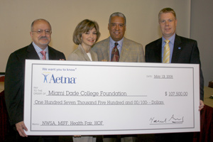 Check being given to Miami Dade College