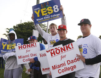 Miami Dade College students hold signs in support of Amendment 8.