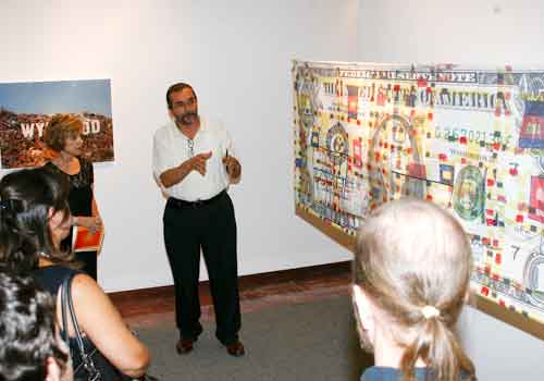 Patrons hear about the artwork in 'Miami: City – Metaphor' during the opening night of the exhibition.