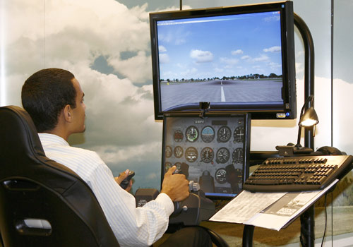 A student on a flight simulator