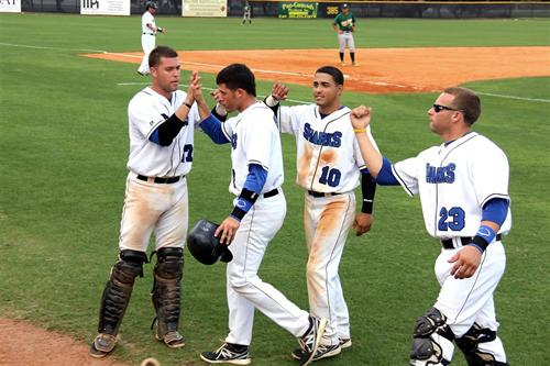 MDC baseball players celebrate a good play