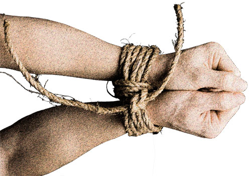Arms and fists bound together by a rope.