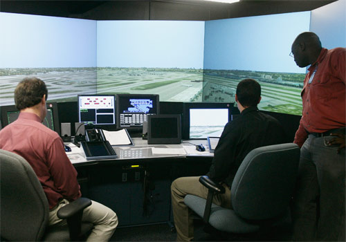 An air traffic control instructor works with MDC students in a high-tech simulator.