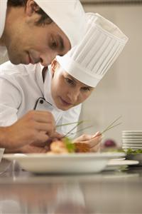 Students plating a dish