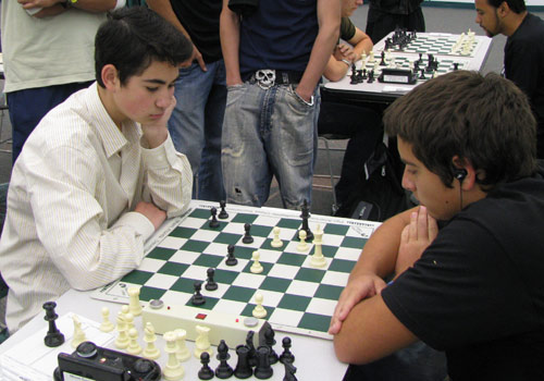 Two high school students concentrate during a tournament match.