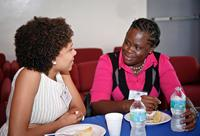 Luciana Da Cruz Brito, left, of Brazil, chats with fellow Fulbright recipient Maxine Browne, of St. Vincent.