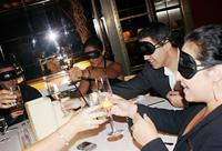 """Dining in the Dark"" events at Miami Beach restaurants teach participants about the challenges faced by those with impaired vision."