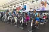 MDC students exercising while using the cardio equipment