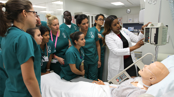 Instructor And Students In Patient Simulator Lab